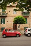 Small car on the street rome near the house royalty free stock images