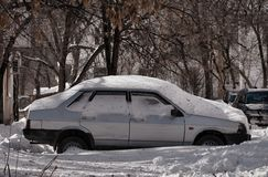 Car and street under snow. Royalty Free Stock Images