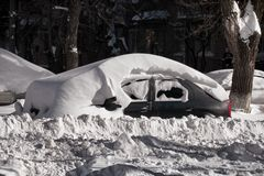 Car and street under snow. Royalty Free Stock Photo
