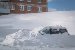 Car stuck in heavy snowbank Stock Images