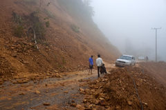 Car stuck in a  landslide. NORTHERN LAOS - AUGUST 14: Car stuck in a  landslide on August 14, 2012 in Northern Laos. Landslides are common in Laos because annual Royalty Free Stock Photos