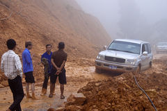 Car stuck in a  landslide. NORTHERN LAOS - AUGUST 14: Car stuck in a  landslide on August 14, 2012 in Northern Laos. Landslides are common in Laos because annual Stock Image