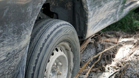 Car stuck in the mud. Gives us a truck stuck in the mud Royalty Free Stock Photo