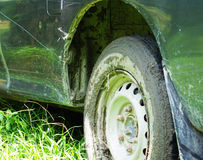 Car stuck in the mud. Gives us a truck stuck in the mud Stock Photo