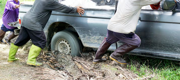 Car stuck in the mud. Man gives us a truck stuck in the mud Stock Images