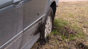 Car stuck in the mud stock footage