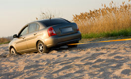 Car stuck in sand Royalty Free Stock Photography