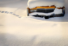 Car Stuck in Snow. Snowy winter with car parked in snow drift buried in snow Royalty Free Stock Photo
