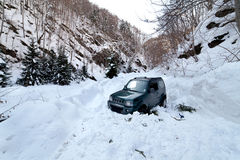 Car stuck in a snow avalanche. 4x4 car being stuck in a snow avalanche in a canyon Royalty Free Stock Image