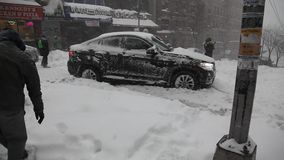 Car stuck in snow during blizzard Jonas. BRONX, NEW YORK - JANUARY 23: Car stuck in snow during blizzard Jonas.  Taken January 23, 2016, in the Bronx,  New York stock video footage