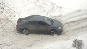 Car stuck in the snow stock footage