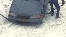 Car stuck in the snow stock video