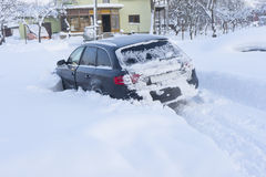 Car stuck in snow near privat home Stock Photo