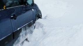 Car stuck in the snow. Snow element. Snow disaster drove the driver to a standstill stock video footage