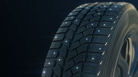 Car studded winter tyre wheel rotate on camera in stock footage