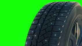 Car studded winter tyre wheel rotate on camera in stock video
