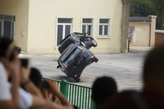 Car stunt performance. People watching car professional stunt performance stock photography