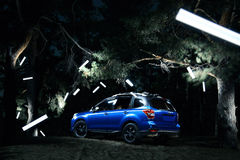 Car Subaru Forester stand in forest, concept lights at night Royalty Free Stock Images