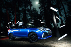Car Subaru Forester stand in forest, concept lights at night Royalty Free Stock Photos
