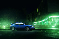 Car Subaru Impreza WRX stand in Moscow city near modern buildings at night. Moscow, Russia - November 21, 2015: Car Subaru Impreza WRX stand in Moscow city near Stock Photos