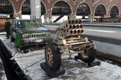 Car of the suicide bomber Jihad-mobile and artillery installation, captured from terrorists, on the platform of the train `Syria stock images