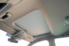Car sunroof. A closed sunroof on a passenger car Royalty Free Stock Photos