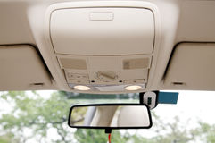 Car sunroof console. Close-up of the modern car sunroof console Royalty Free Stock Photography