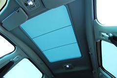 Car sunroof. Photo large sunroof inside car, sky and clouds Stock Photography