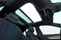 Car sunroof. Photo large sunroof inside car, sky and clouds Royalty Free Stock Photography