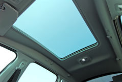 Car sunroof. Photo large sunroof inside car, sky and clouds Stock Photo