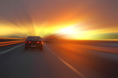 Car at sunset. On the highway royalty free stock photo