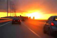 Car at sunset. On the highway Stock Photo