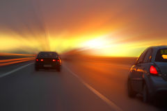 Car at sunset. On the highway Royalty Free Stock Image