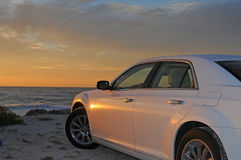 Car and sunset royalty free stock photos