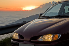 Car and sunset Stock Images