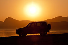 Car on sunset background Stock Image