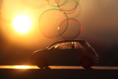 Car at sunset with bubbles Royalty Free Stock Images