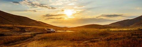 Car at sunset Royalty Free Stock Photo