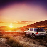Car at sunset. Fantastic orange sky with cumulus clouds. Beauty world Royalty Free Stock Photography