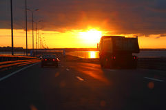 Car at sunset highway. Cars at sunset on highway royalty free stock photography