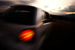 Car at sunset low lighn image Royalty Free Stock Images