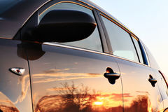 Car sunset reflection Stock Photography