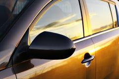 Car sunset reflection. Black car Royalty Free Stock Images