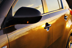 Car sunset reflection Royalty Free Stock Images