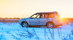 Car at sunset winter Royalty Free Stock Photography