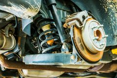 Car Suspension and Brakes. Maintenance in Auto Service Stock Photography