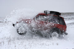 Car SUV breaks snowdrift Stock Image