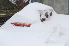 Car swept over the roof in snow storm Royalty Free Stock Photos