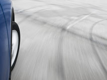 Car swerving. Motion blur shot of a car driving in a curve Royalty Free Stock Photos
