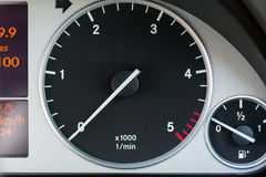 Car tachometer. Close-up of a car dashboard with a tachometer and fuel indicator Stock Photo